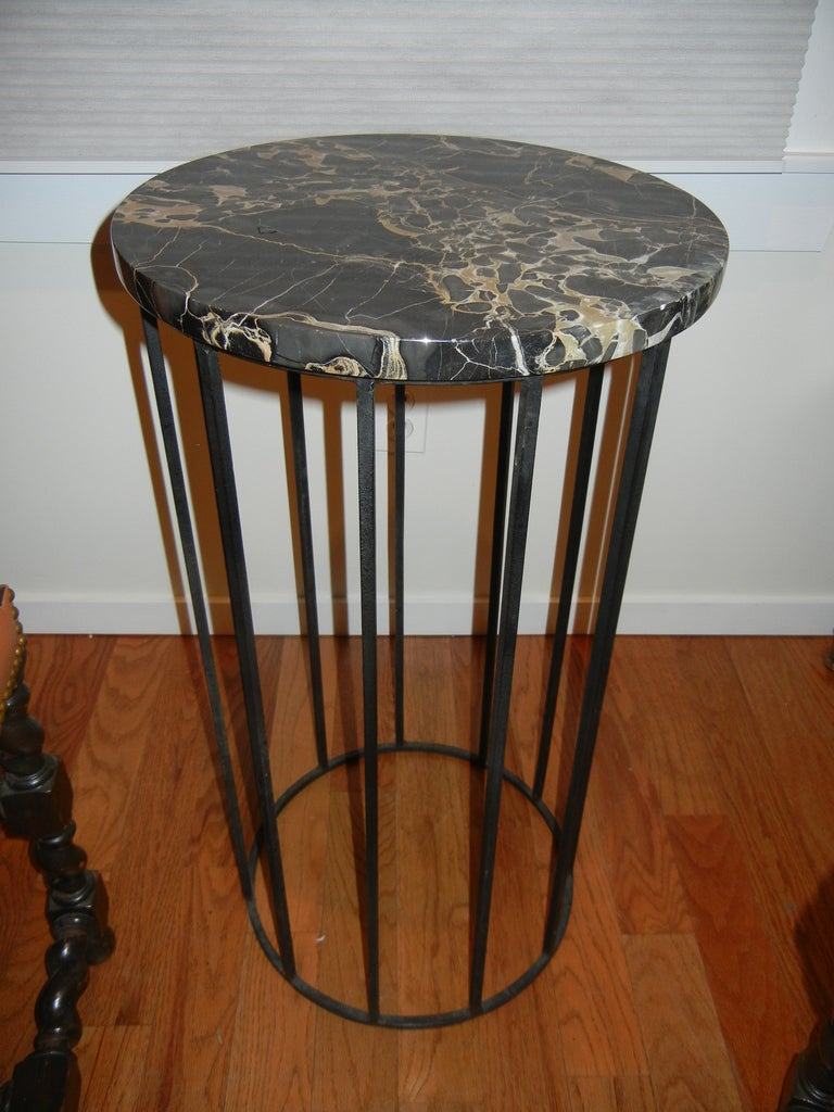 An English iron and marble table/stand. Very versatile, could be used to hold plants, bronzes or lighting. Can be considered Industrial.